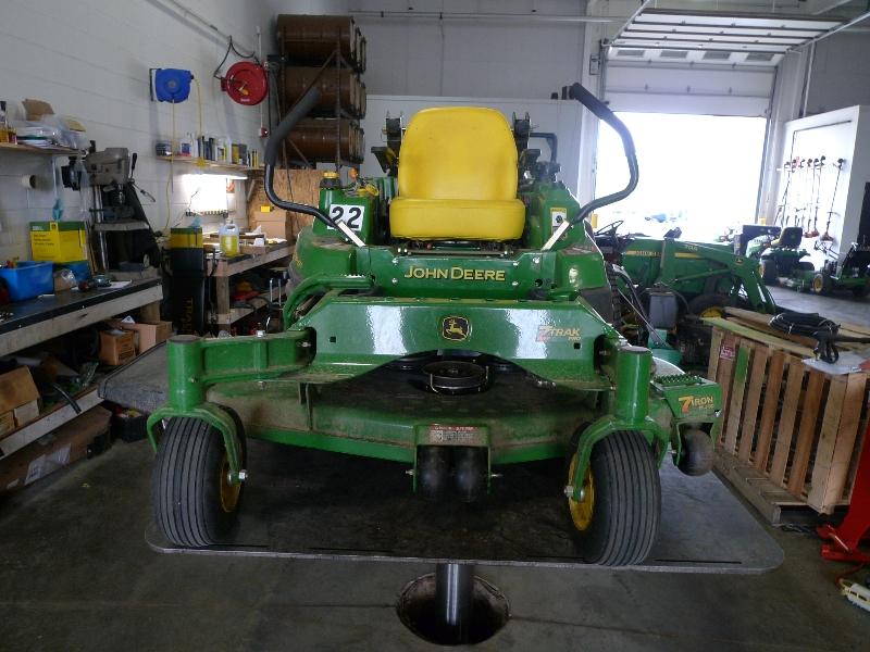 john deere riding lawn mower on equipment lift