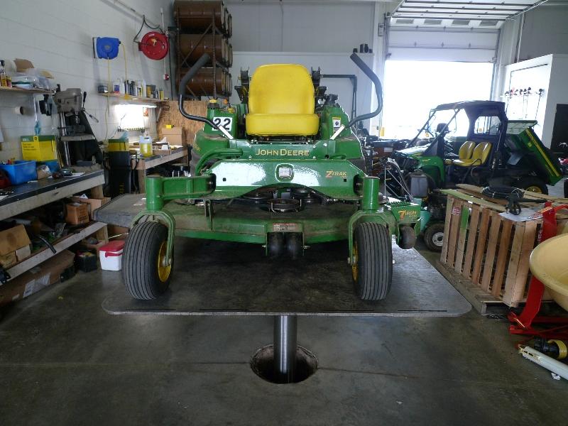 zero turn riding lawn mower on lift