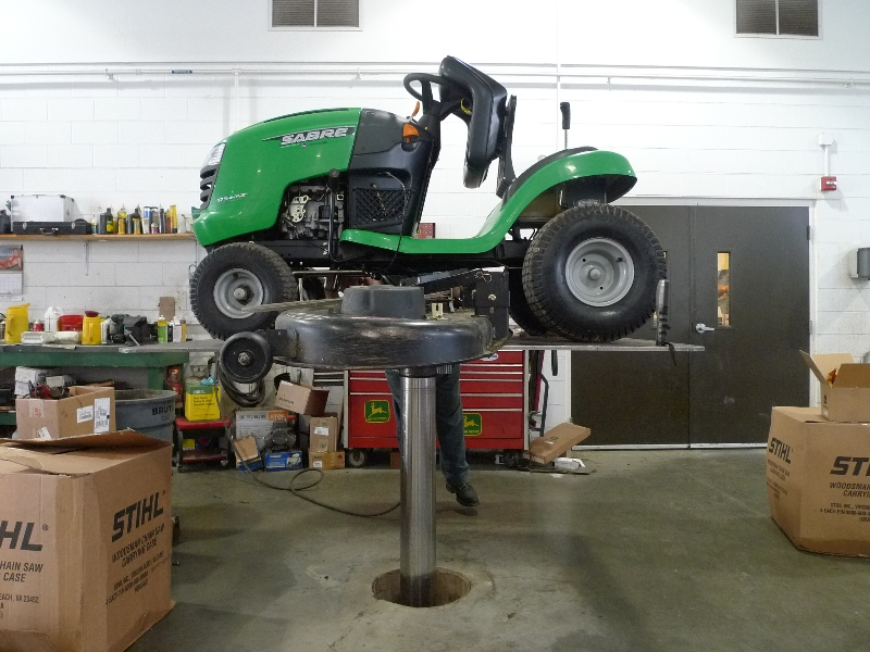 side view of green riding lawn tractor