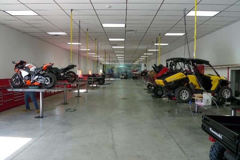 large equipment on quakermayd lift in mechanic shop