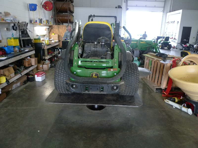 back of riding lawn mower on lift