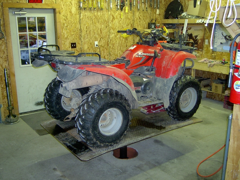 dirty atv getting repaired on quakermayd lift