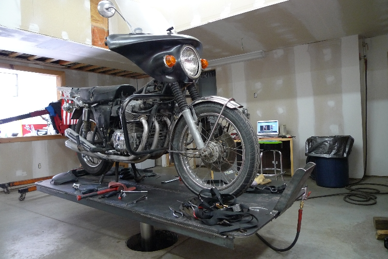 motorcycle on a quakermayd lift