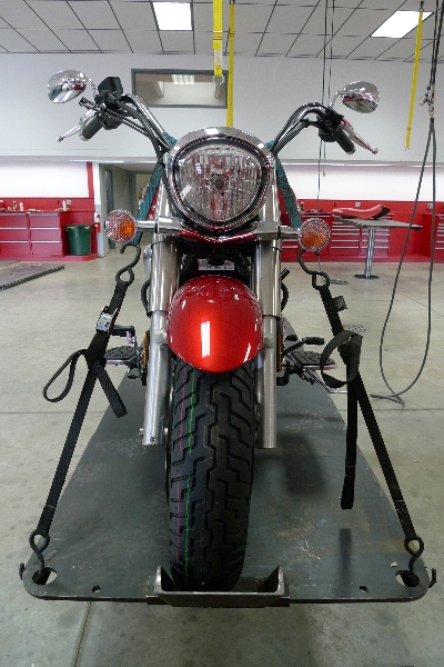 motorcycle stand in automotive lift