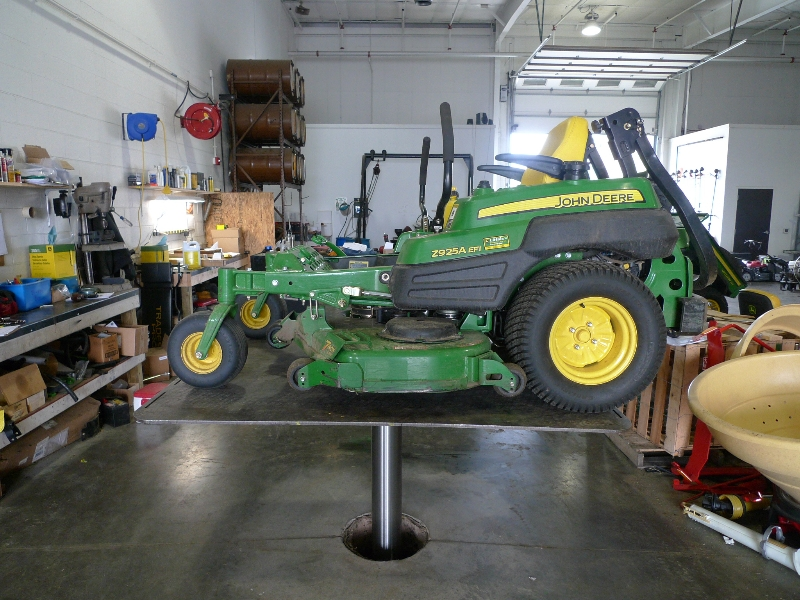 quakermayd lift with lawn mower on it